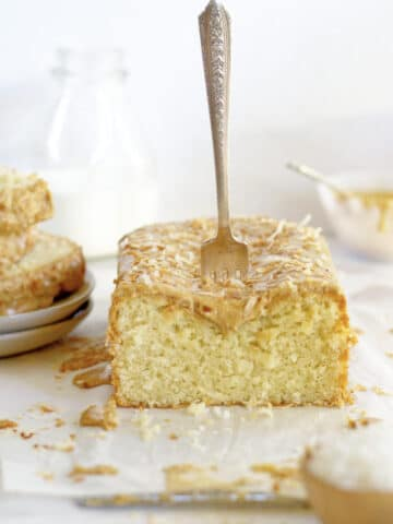 kona coconut loaf cake with a fork stuck in the top of it