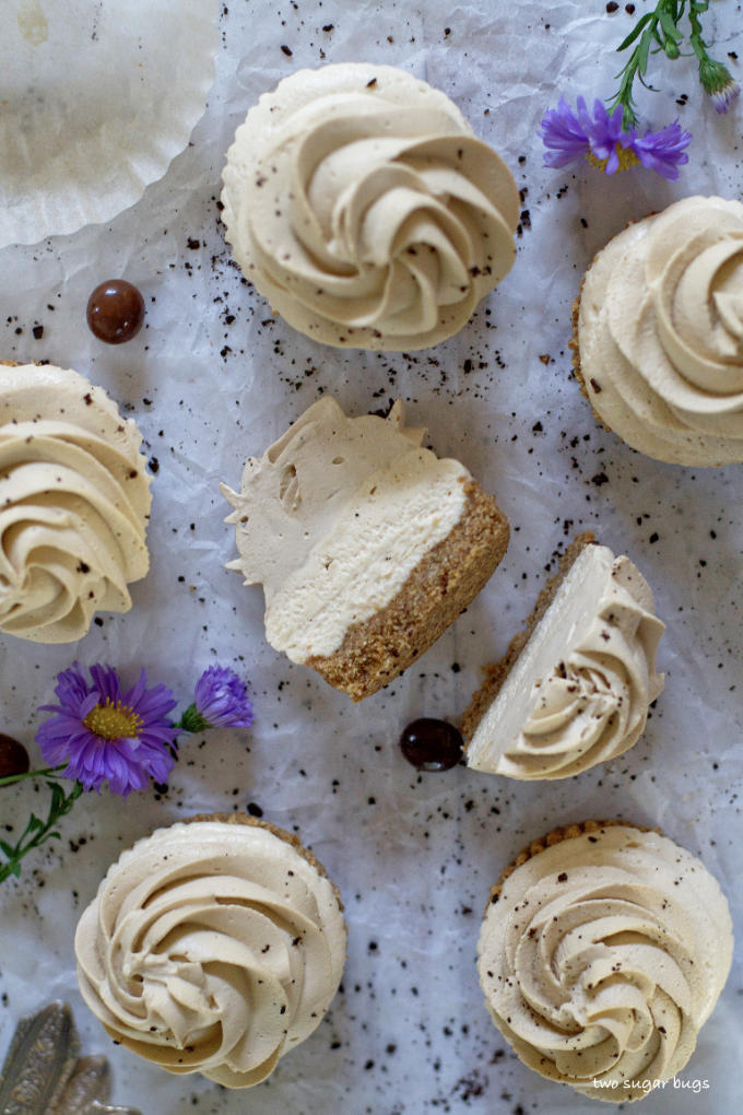 mini cheesecakes on parchment paper, with a slice shot showing the layers
