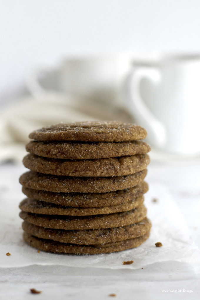 stack of cookies with a coffee mug in the background