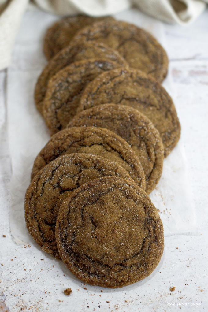 a line of cookies on parchment paper