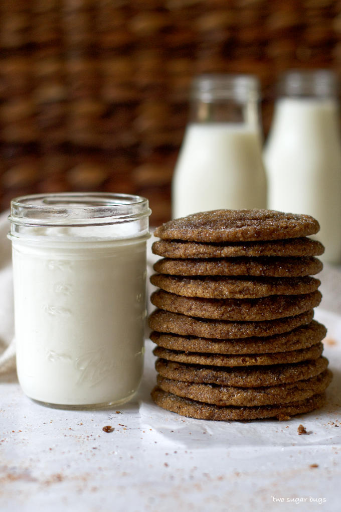 stack of pumpkin gingerbread cookies next to a glass of milk