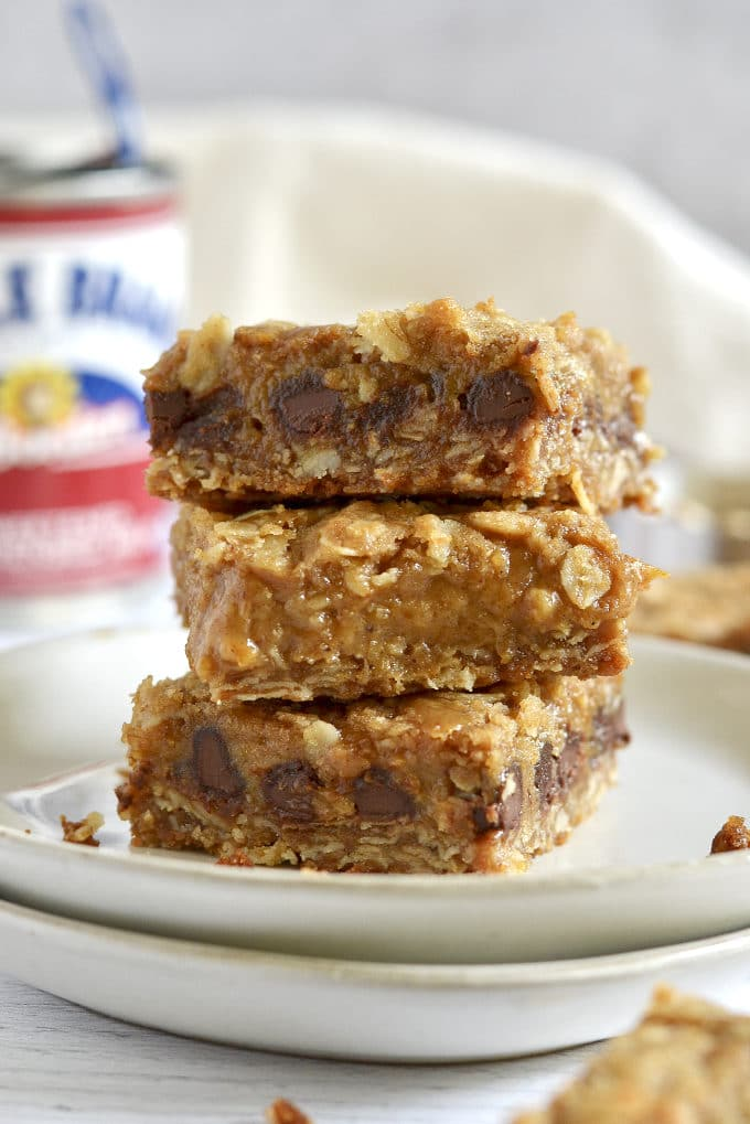 stack of three pumpkin caramel bars on a plate