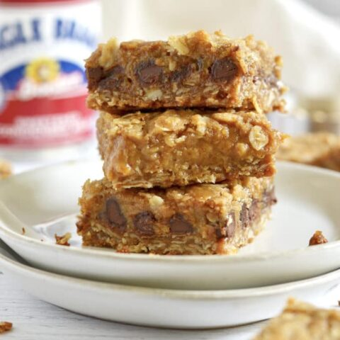 Stack of three pumpkin caramel spice bars on a plate.