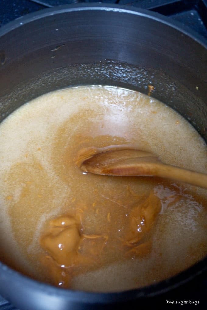 cookie butter added to cookie base in a saucepan