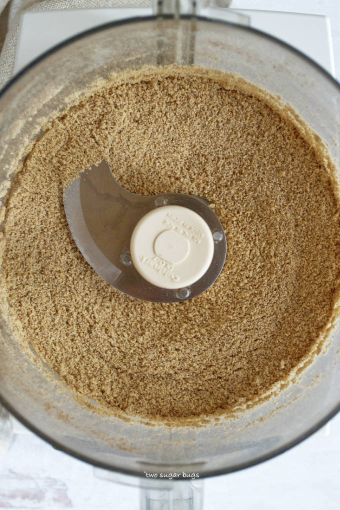 ground graham crackers, sugar and espresso powder in the bowl of a food processor