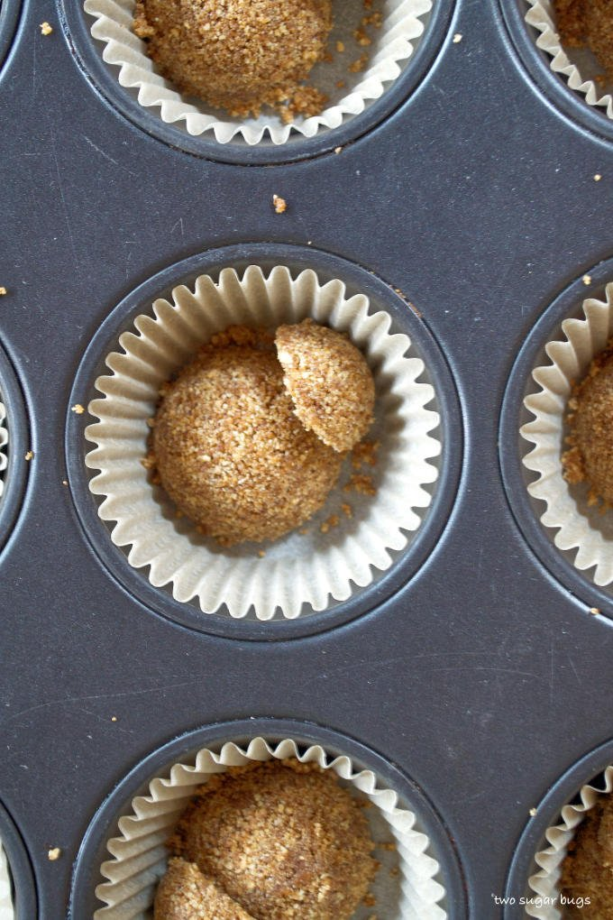 espresso graham cracker crust measured into muffin pan liners