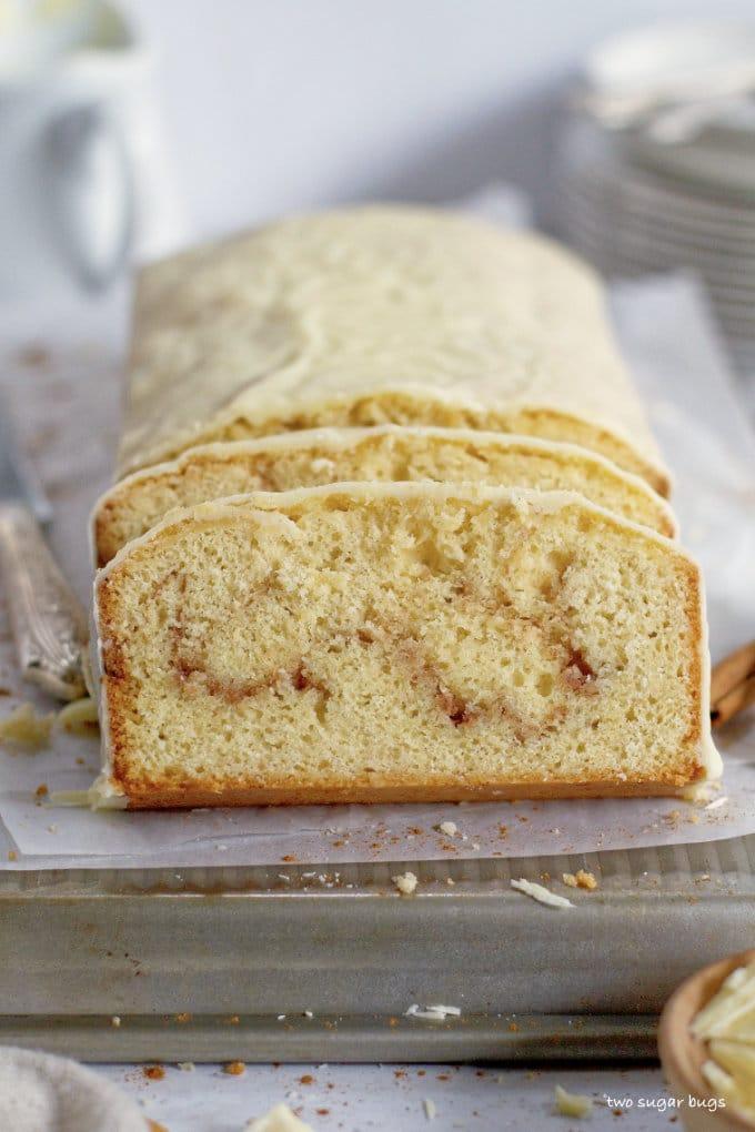 sliced cake sitting on a baking pan