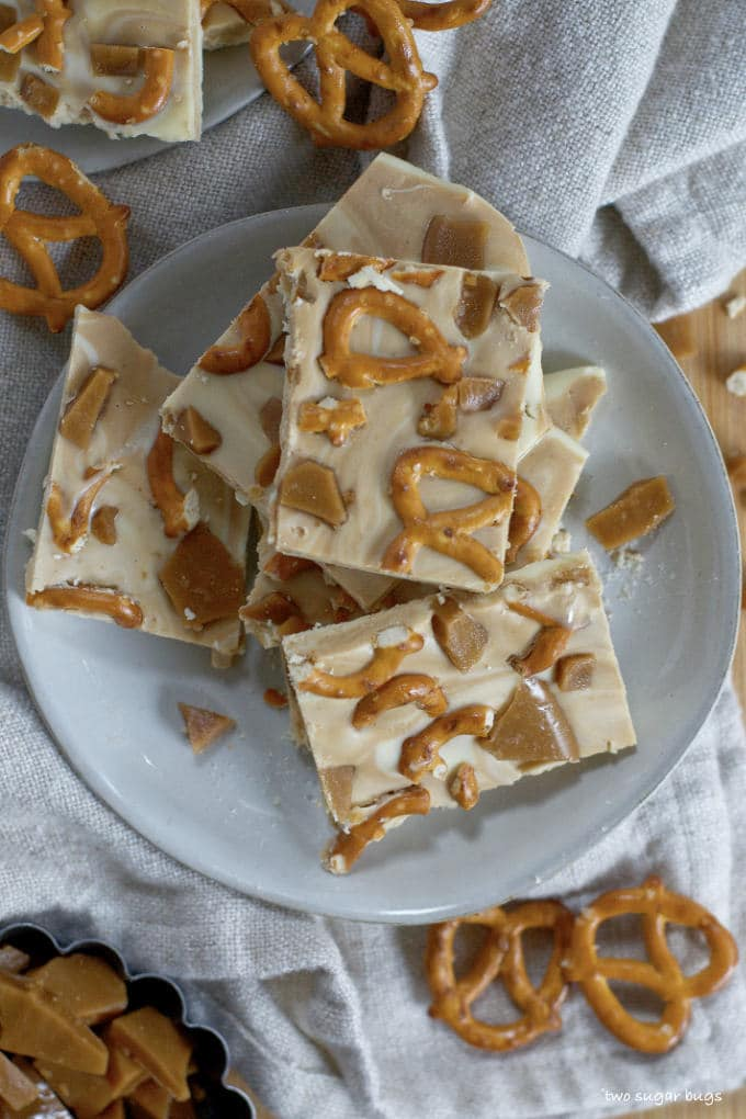 cookie butter white chocolate bark piled on a plate