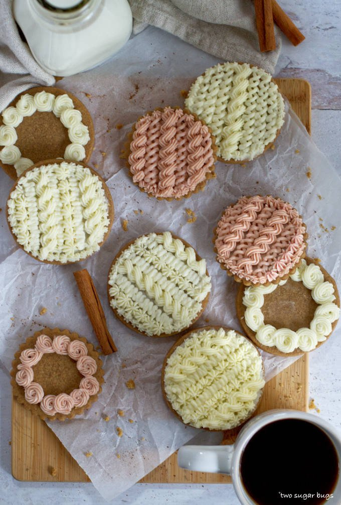 decorated cable knit sweater cookies on parchment paper