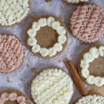 decorated soft gingerbread cookies on parchment paper