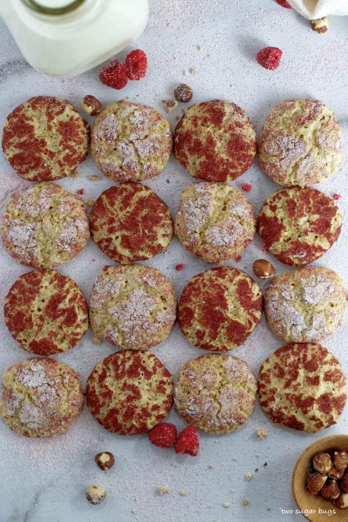 overhead shot of raspberry hazelnut cookies and milk