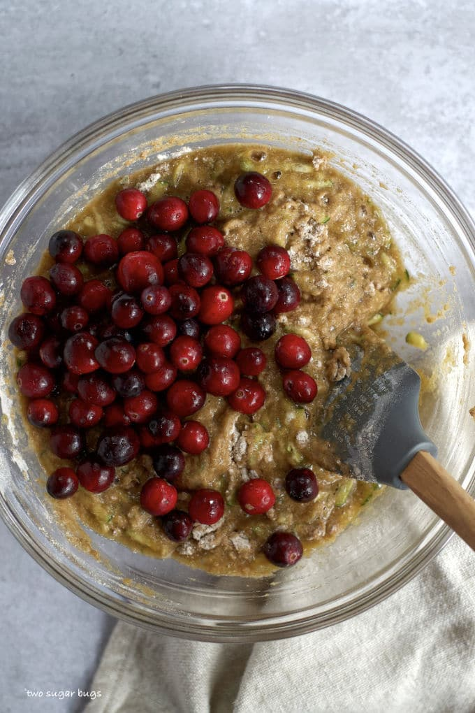 cranberries on top of whole wheat cranberry zucchini bread batter