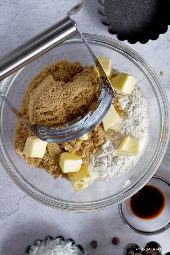 butter, brown sugar and all-purpose flour in a bowl with a pastry cutter