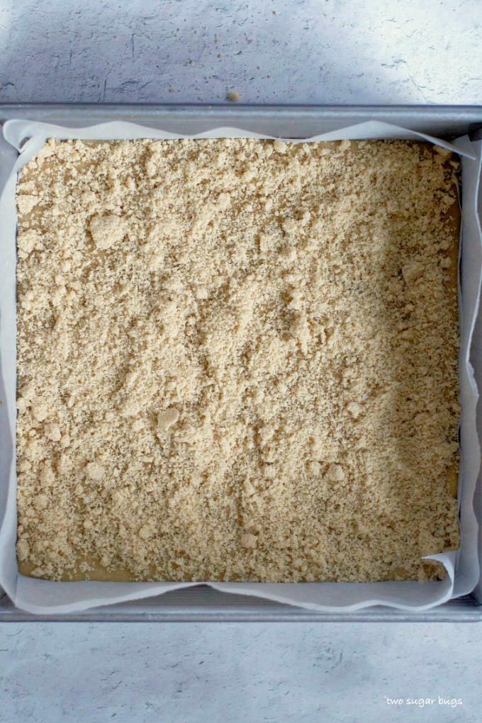 reserved dry ingredients sprinkled on top of brown sugar snack cake batter