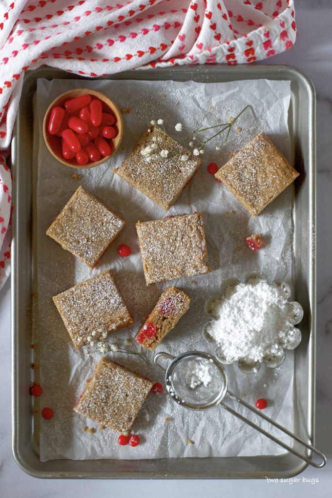overhead look at red hot cinnamon cookie bars on a baking sheet