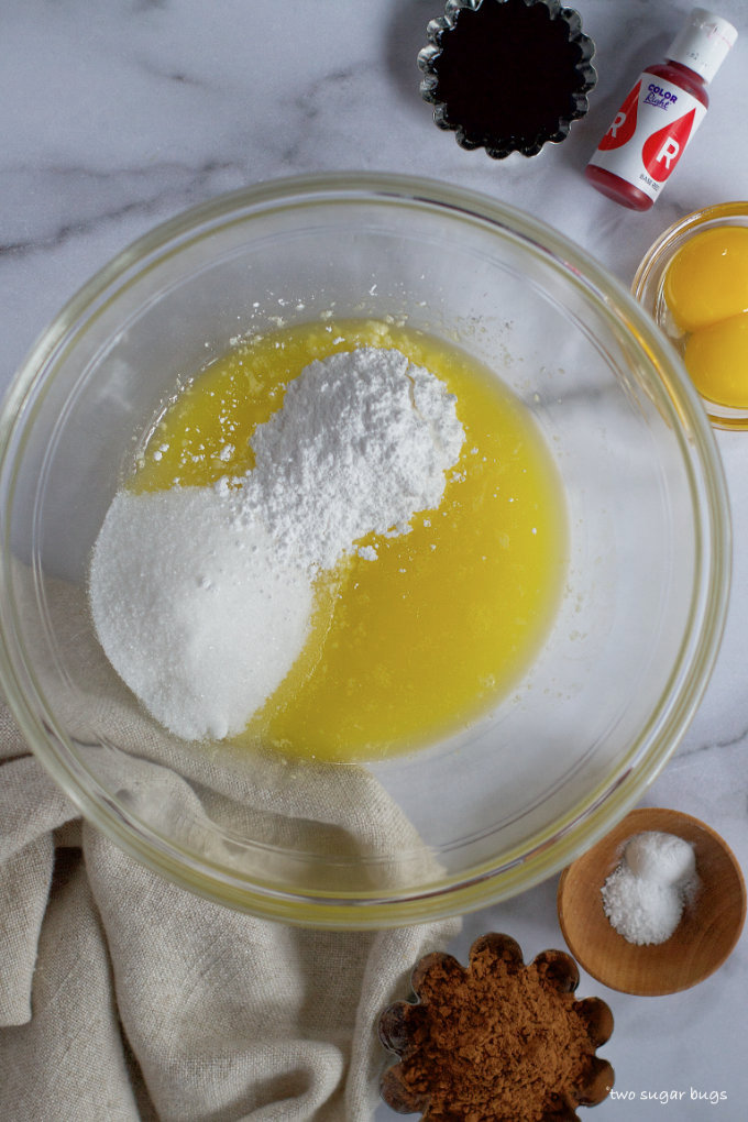 melted butter, granulated and confectioners' sugar in a bowl
