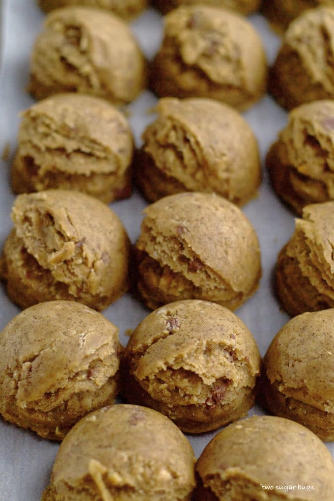 espresso brown butter toffee cookie dough scoops on a baking sheet