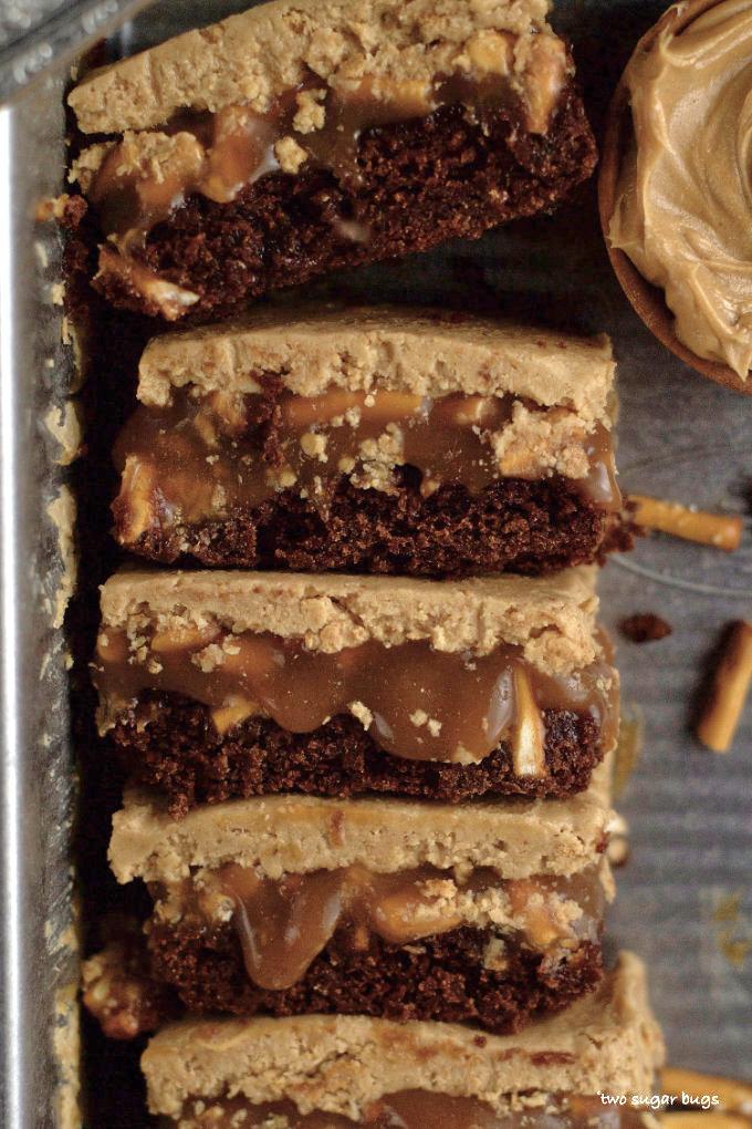 a stack of peanut butter caramel pretzel brownies