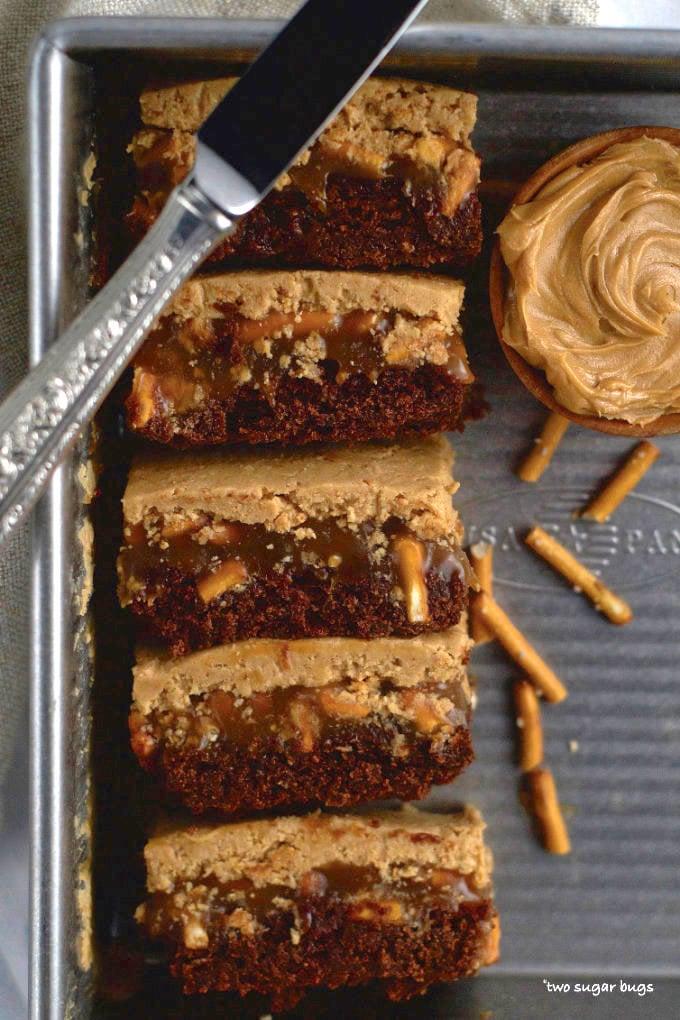 side view of peanut butter caramel pretzel brownies in a baking pan