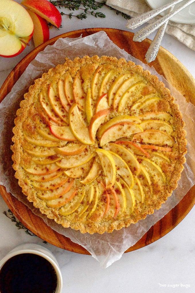 baked apple frangipane tart on a wood plate