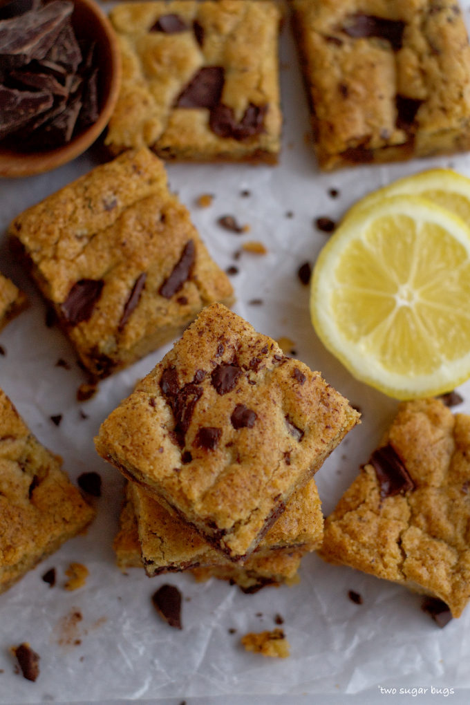 stack of lemon almond cookie bars with lemon slices