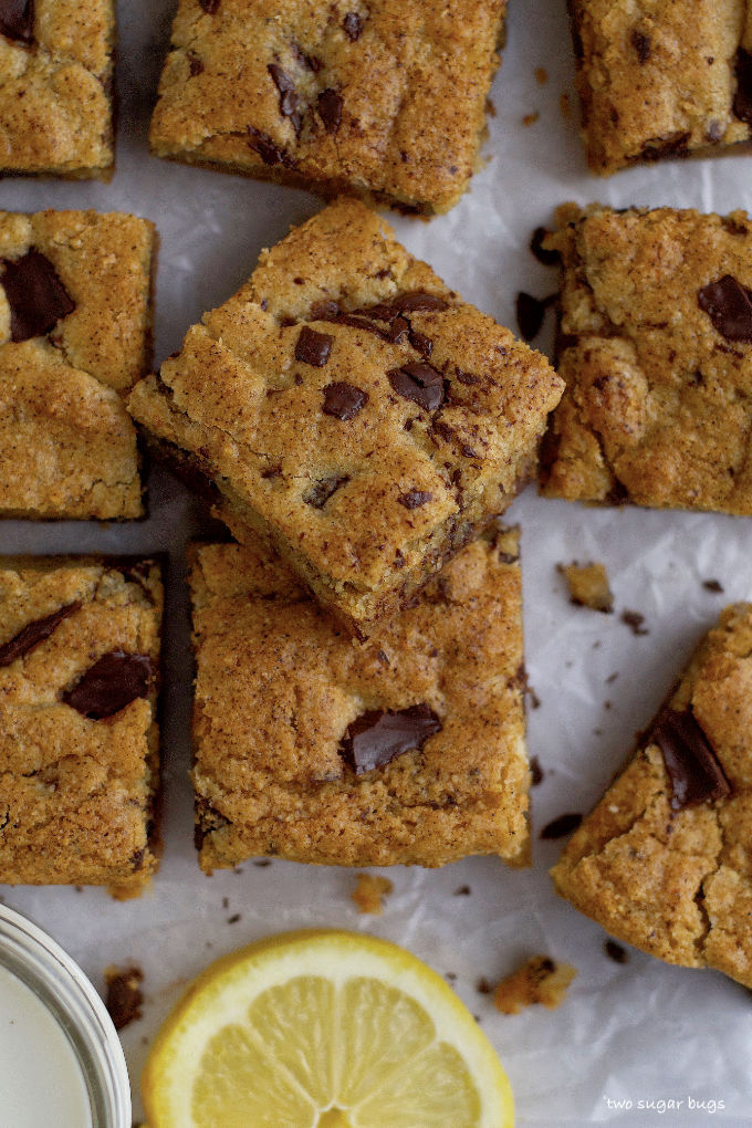 cookie bars on parchment with a lemon