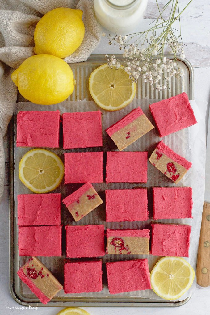 cut squares on a baking pan with lemons