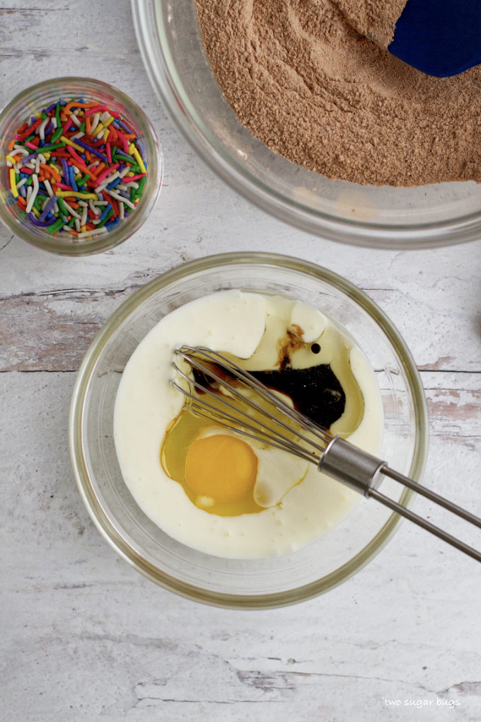 buttermilk, egg and vanilla in a bowl with a whisk