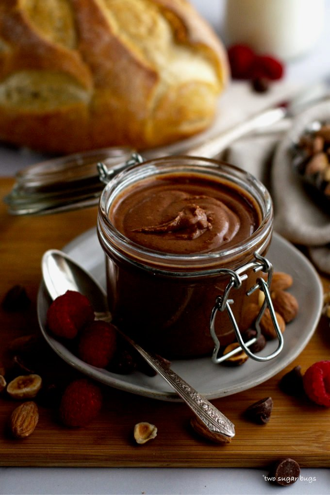 jar of homemade chocolate almond spread with a loaf of bread