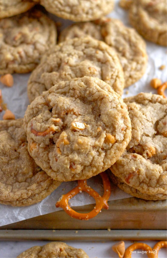 a pile of cookies with pretzel bits and butterscotch chips