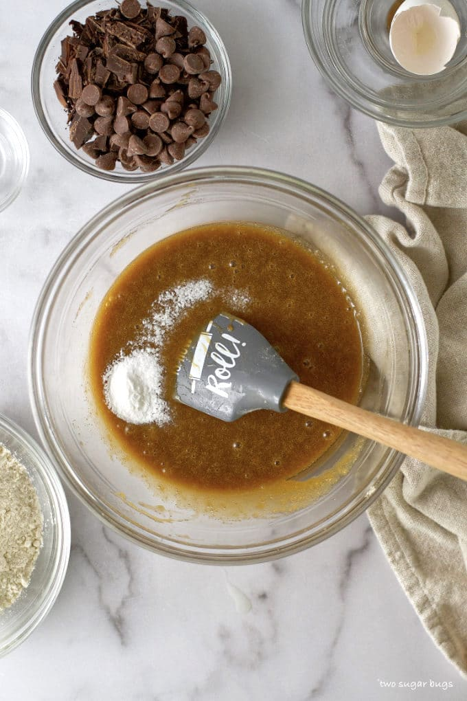 baking soda and kosher salt on top of wet ingredients in a bowl