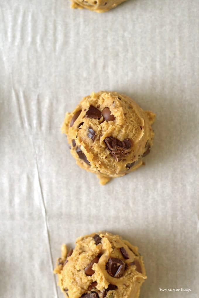 malted chocolate chip cookie dough on a parchment lined baking sheet