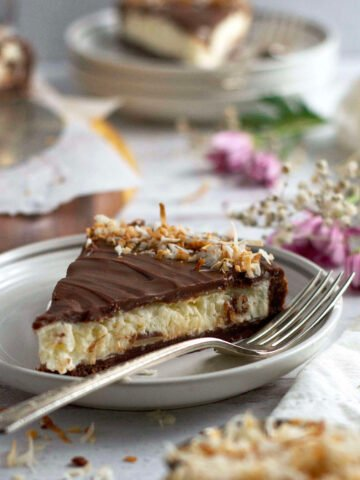 slice of almond joy pie on a plate with a fork
