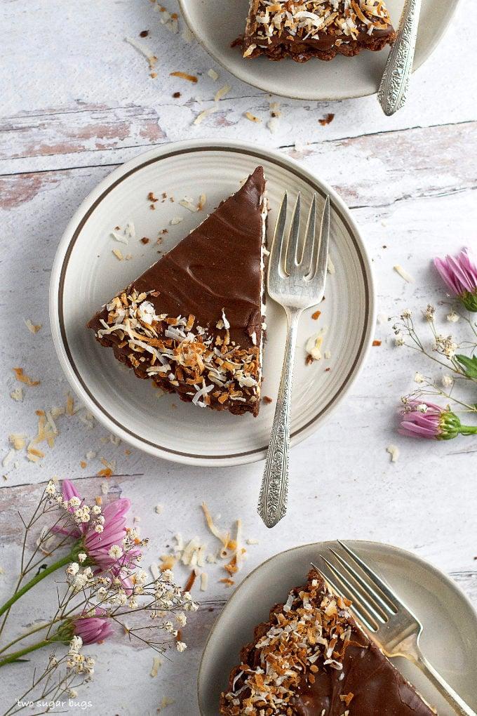 three slices of almond joy pie on plates