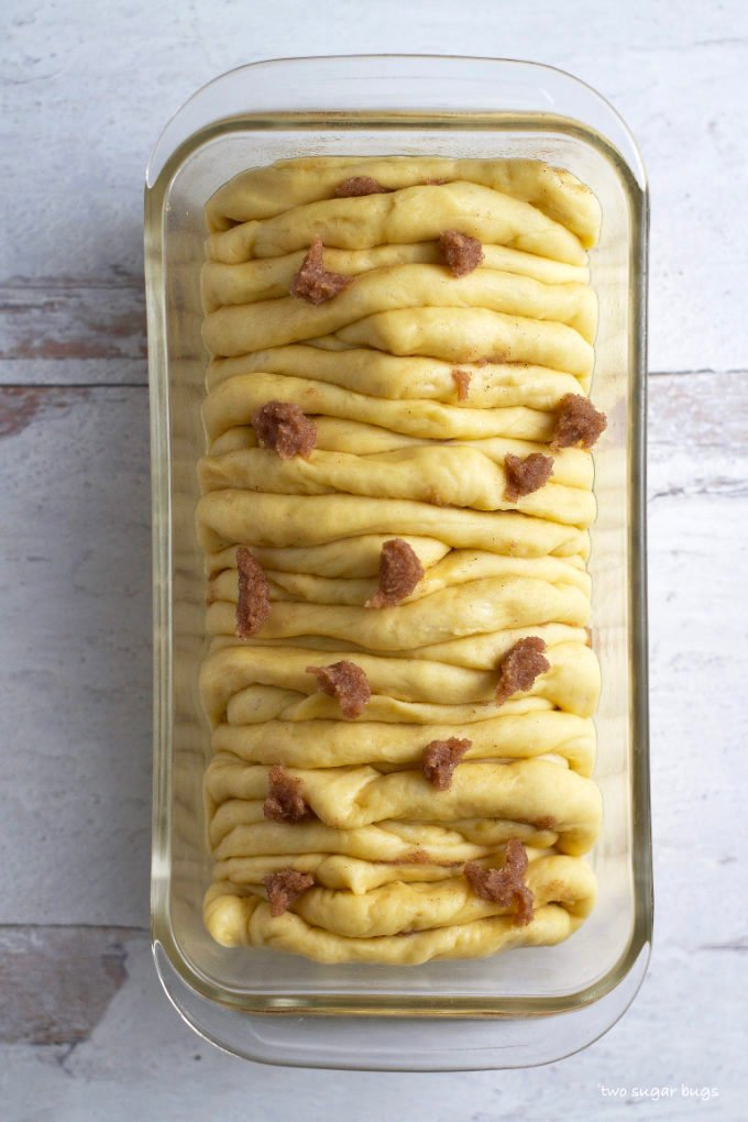 sweet cinnamon pull apart bread with cinnamon sugar over the top prior to baking