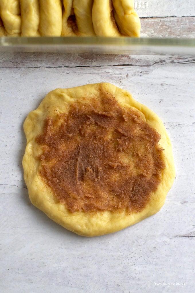 bread dough circle with a layer of cinnamon sugar