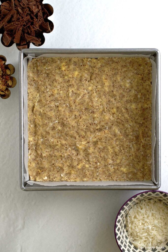 unbaked buttery almond flour base in baking pan