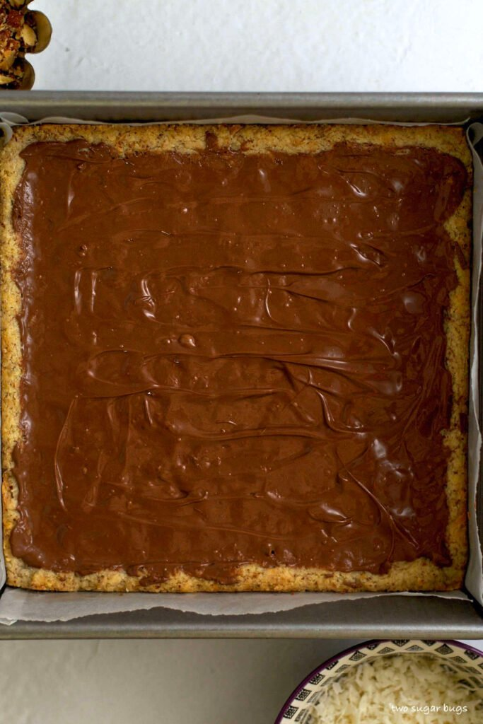 chocolate layer spread over buttery almond base