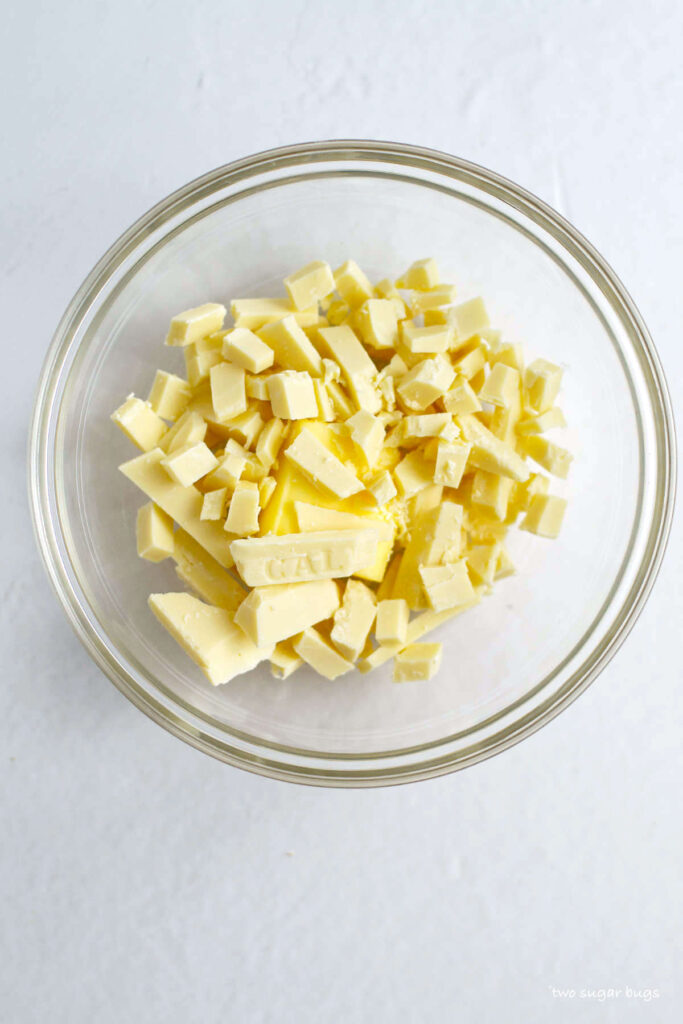 chopped white chocolate and butter in a bowl