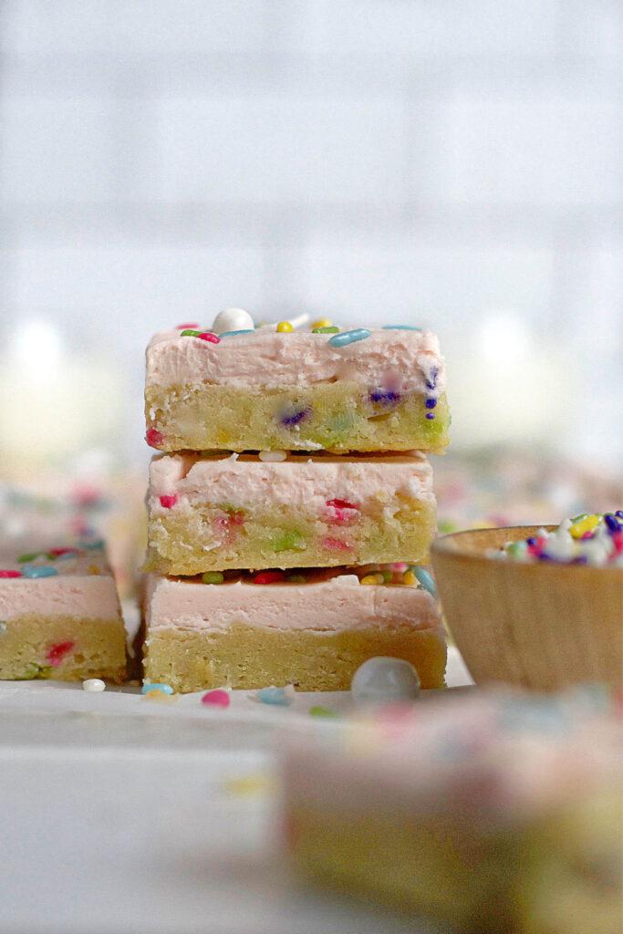 stack of three sugar cookie bars with sprinkles