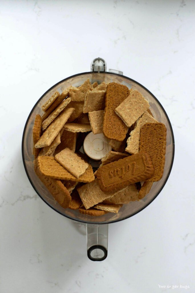 biscoff cookies and graham crackers in a food processor bowl