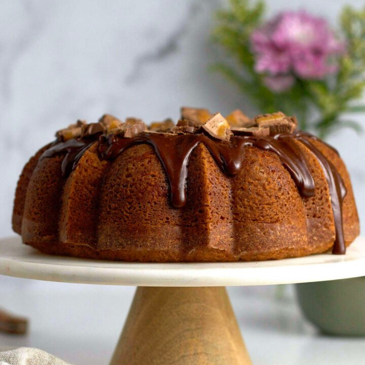 Milky Way cake with chocolate ganache glaze on a cake stand