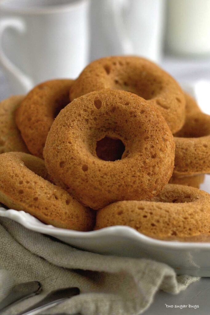 baked, unglazed peanut butter donuts on a plate