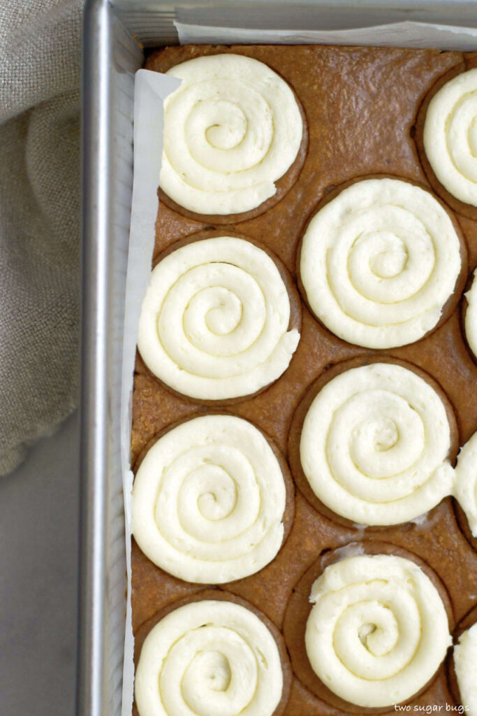 no bake pumpkin cookies with cream cheese frosting in the baking pan