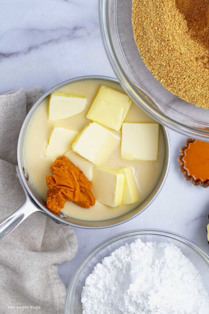sweetened condensed milk, butter and pumpkin puree in a saucepan