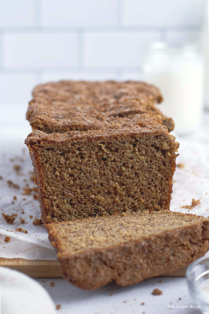 banana bread on parchment lined cutting board