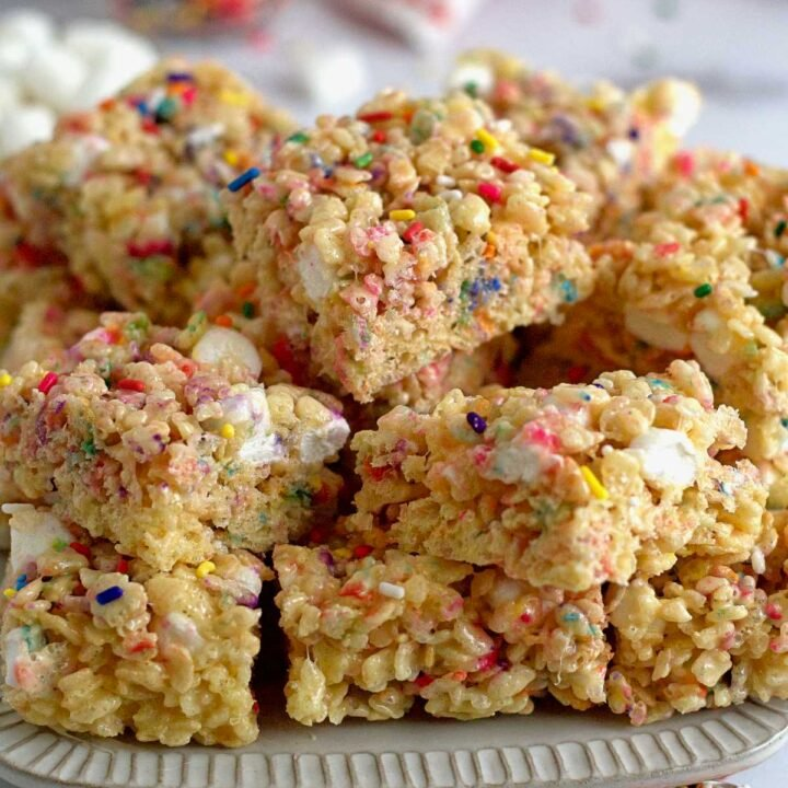 a plate filled with sprinkle Rice Krispie treats