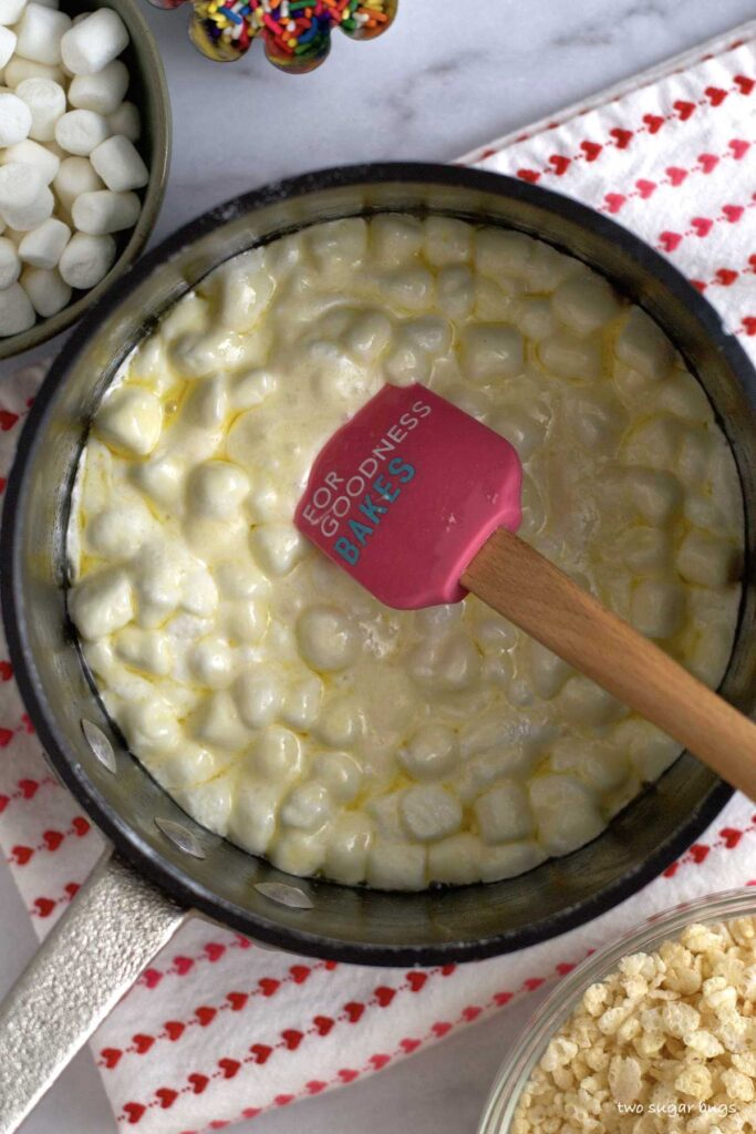 marshmallows just added to melted butter in a saucepan