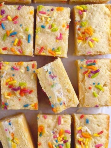 close look at the funfetti frosting stuffed inside sugar cookie sandwiches